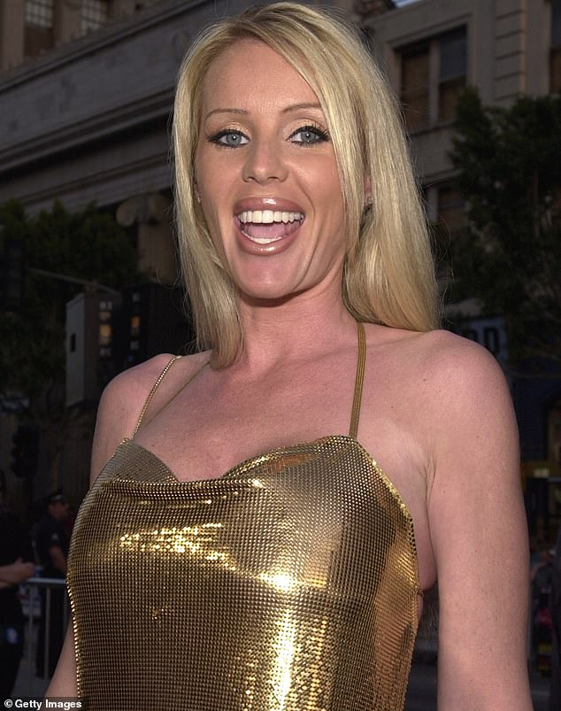 Trouble: The 52-year-old blonde beauty - who has appeared in the films Beverly Hills Cop III and Alpha Dog - was petting one of her pitbulls last week when the other one became jealous. Parkhurst was unfortunately stuck in the middle of their fight. The cover girl was seen at the premiere of Driven in 2001
