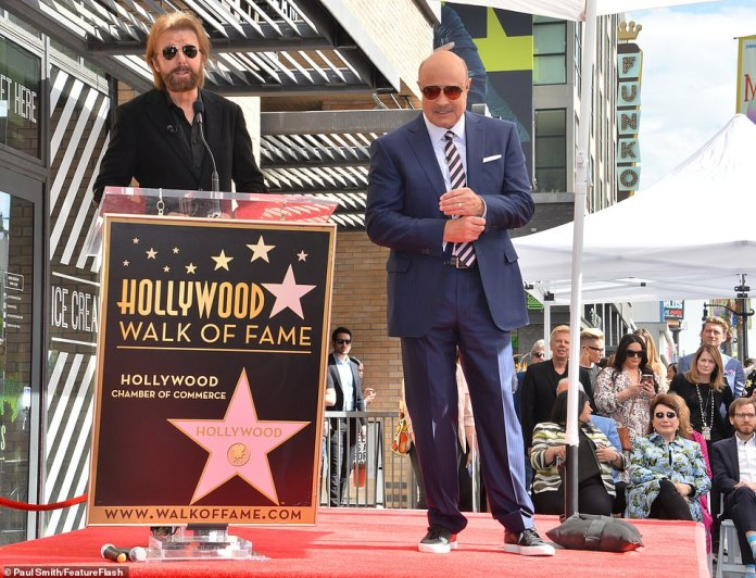 Big moment: Country music singer-songwriter and record executive Ronnie Dunn took to the podium to honor Dr. Phil in front of the TV icon's friends, family and fans