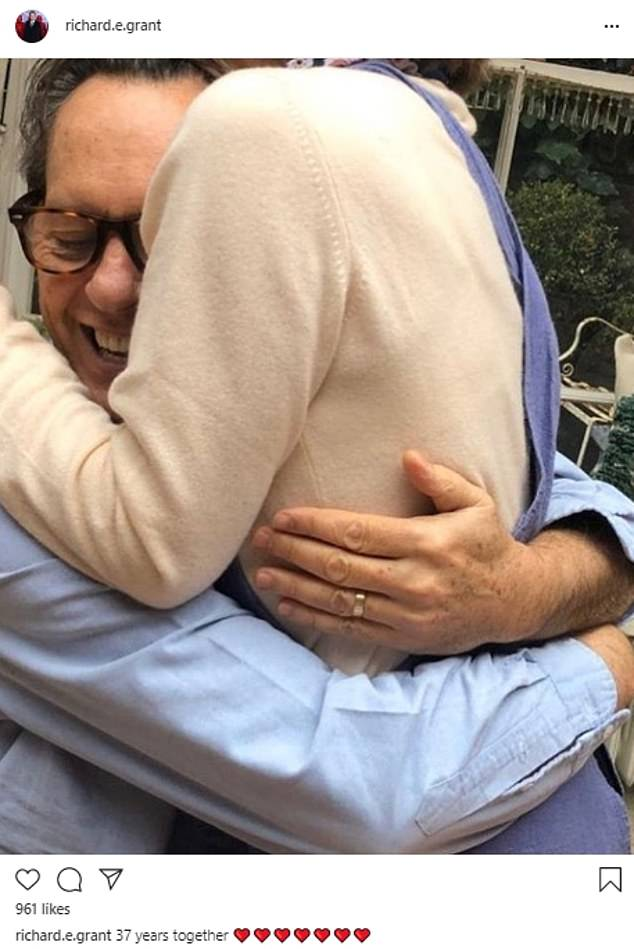 Love story:Richard E. Grant shared a heart-warming image of he and wife Joan Washington embracing to mark 37 years together