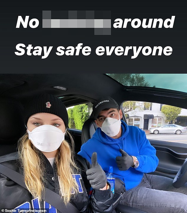 'Stay safe everyone':Boybander Joe Jonas (R) and his pregnant wife - Game of Thrones alum Sophie Turner (L) - were 'not f***ing around' on Sunday and donned masks and surgical gloves