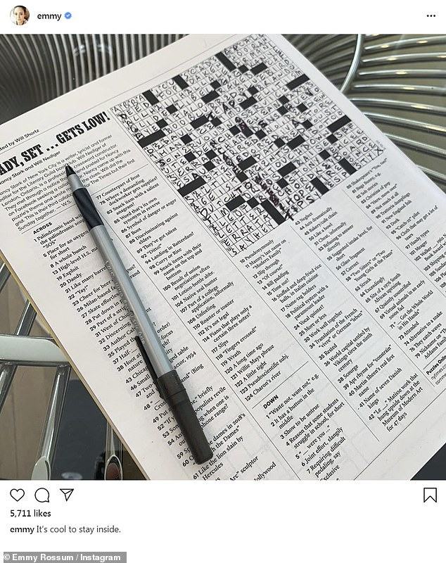 SO cool: 'It's cool to stay inside,' wrote Rossum who dove head first into a crossword puzzle during her self-quaratine