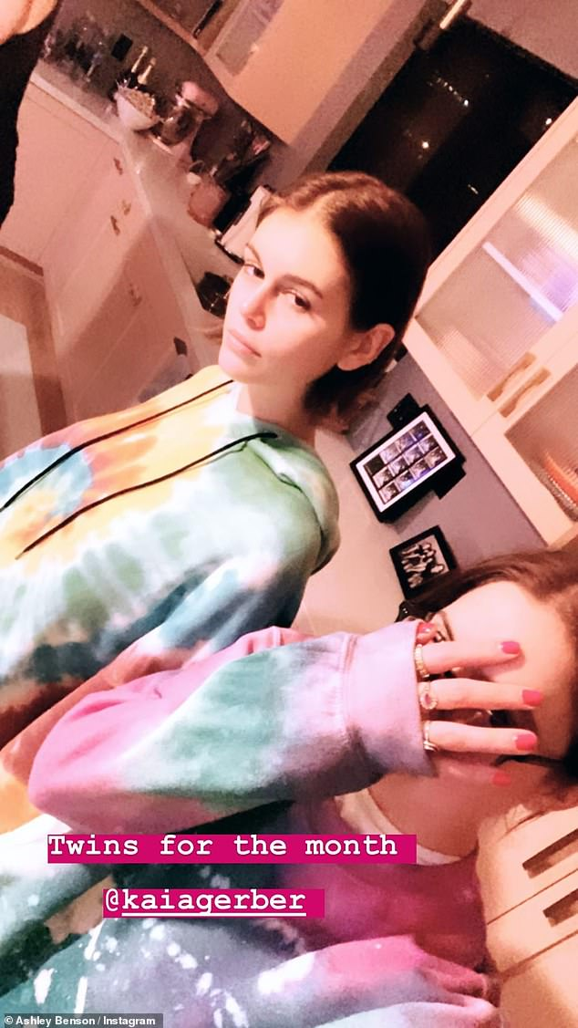 All together: Kaia Gerber strayed away from social distancing and instead had a cleaning party with pal Ashley Benson and Benson's girlfriend Cara Delevigne