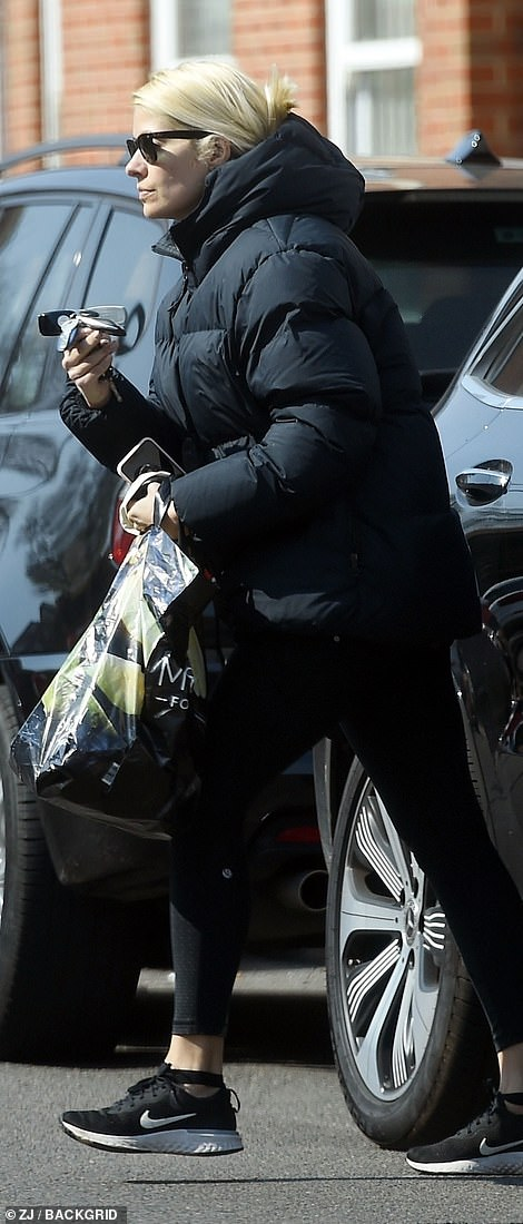 Ready to shop: The star was initially seen emerging from her car with empty bags, ready to pick up goods for her family - husband Dan Baldwin, 45, and children Harry, 10, Belle, eight, and Chester, five
