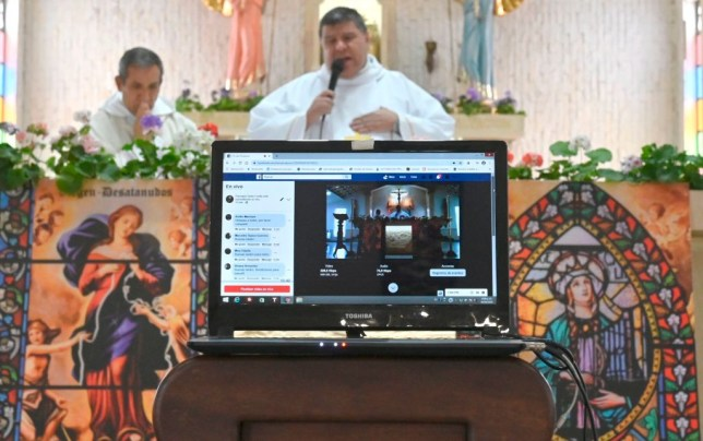 a Priest delivering an online church service