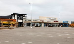 A shopping center with closed retail stores due to the COVID-19 outbreak in Farmington Hills, Michigan.