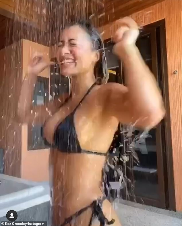 Shower:The reality star set pulses racing as she donned a black bikini and joked in the caption that she was 'washing away the corona'