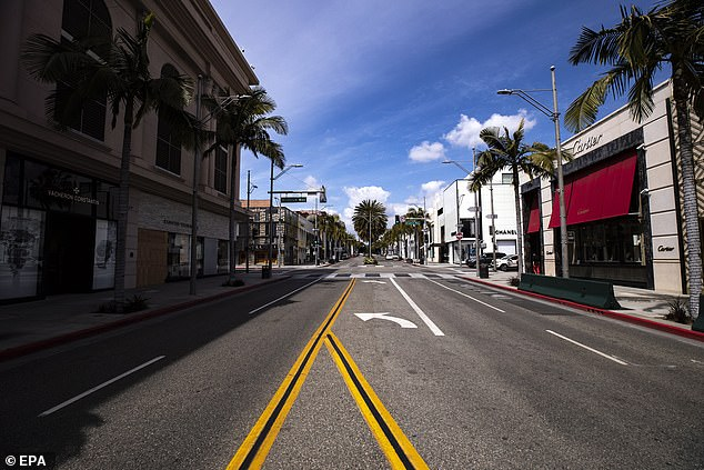 Rodeo Drive is empty and its luxury goods stores are closed amid the coronavirus pandemic in Beverly Hills, California