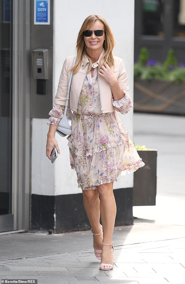 Spring in her step: She had a big smile on her face as she was pictured leaving the studios and heading back home