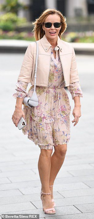 Spring has sprung: Amanda teamed her dress with pretty pink sandals and a matching cropped jacket