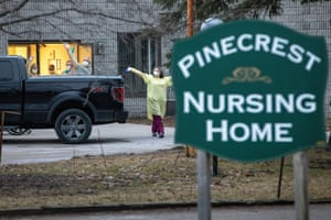Staff at the Pinecrest nursing home in Bobcaygeon, Canada, wave to passing cars sounding their horns in support after 29 residents died and dozens of staff were made ill by coronavirus.