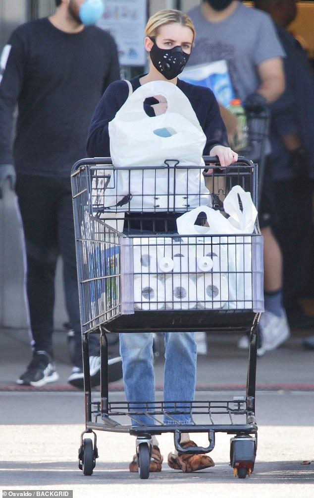 Coveted items: Roberts reappeared with a cart full of paper towels and toilet paper