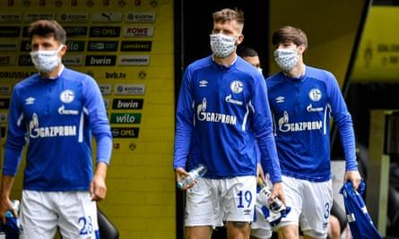 Schalke's players enter the stadium.
