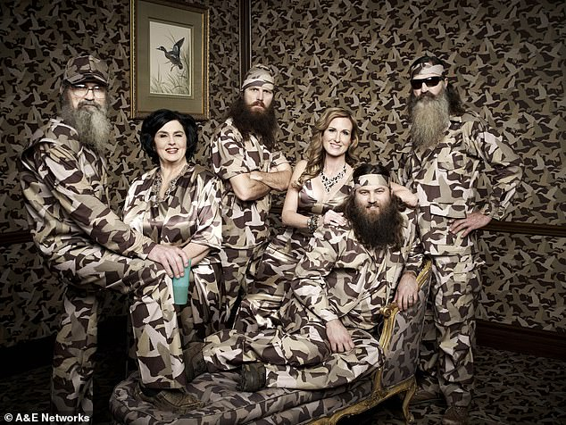 Growing family: Phil said his family has already met his daughter Phylliss, and that fans will get to hear her side of things on an upcoming podcast episode; Phil (right) seen here in 2013 with (from right) brotherSi, wifeKay, son Jase, daughter-in-law Korie, and son Willie Robertson