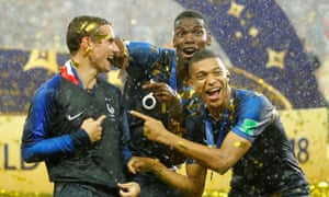 Antoine Griezmann, Paul Pogba and Kylian Mbappé celebrate France's win at the 2018 World Cup.
