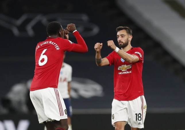 epa08496852 Manchester United's Bruno Fernandes (R) greets teammate Paul Pogba (L), during the English Premier League soccer match between Tottenham Hotspur and Manchester United in London, Britain, 19 June 2020. EPA/MATTHEW CHILDS / NMC / REUTERS POOL EDITORIAL USE ONLY. No use with unauthorized audio, video, data, fixture lists, club/league logos or 'live' services. Online in-match use limited to 120 images, no video emulation. No use in betting, games or single club/league/player publications.