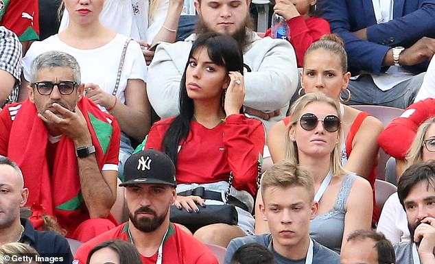 Sparkling accessory: She added weight to growing rumours of an engagement to Cristiano back in June 2018, when she cheered on the footballer at the World Cup in Moscow (pictured)