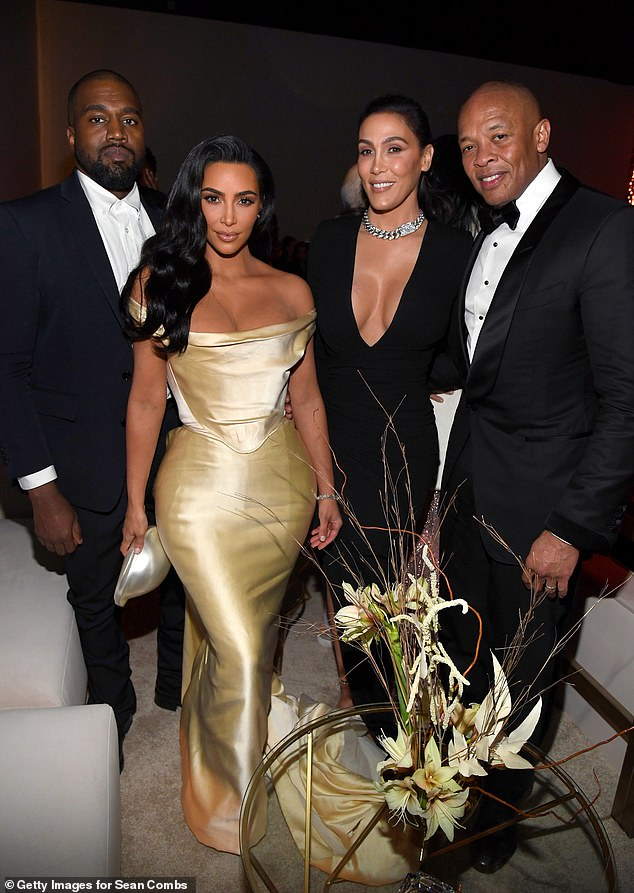 Famous: Dre and wife Nicole pictured with Kanye West and Kim Kardashian West at Sean Combs 50th birthday bash on December 14, 2019 in Los Angeles