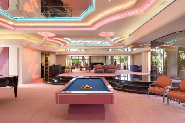 A perfect pad for Barbie! Pink seven-bedroom, 14-bathroom 1980s California estate with a pink roof, mirrored walls, neon lights and a light-up floor is for sale at $5.99 million