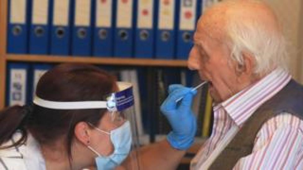 A care home resident is tested for coronavirus