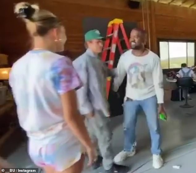 Soft push: Justin Bieber urged Kanye West to get in touch with Kim Kardashian during a visit to the rapper's $14million Cody, Wyoming compound during turbulent times for the star