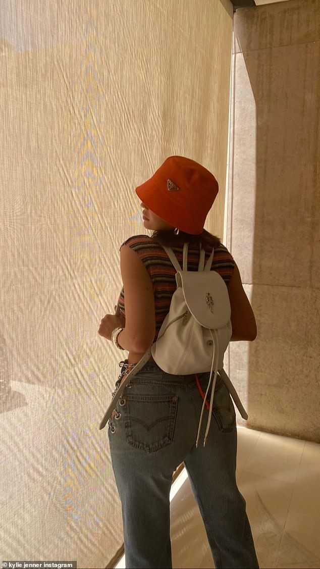 Holiday vibes: Kylie Jenner rocked a retro nineties look in a new Instagram snap from her vacation in the Utah desert and shared a soothing video of rocks and water wishing everyone to 'stay safe' on Thursday