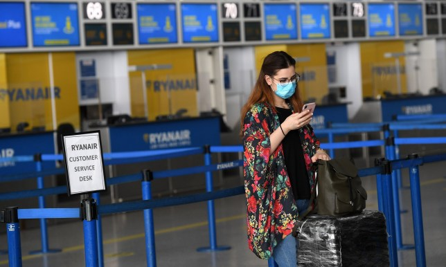 A passenger queues up to check in for a flight at Stansted Airport London