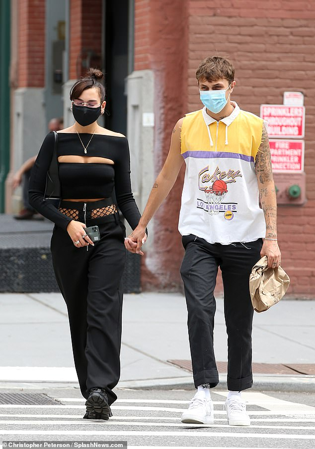 Style Queen:The New Rules hitmaker, 24, cut a very stylish figure in a black cut-out top and matching cargo trousers as she walked with her casually dressed beau, 21