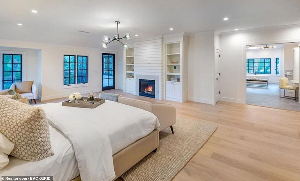 Retreat: There are six bedrooms, all ensuite, and the master suite on the first floor is expansive and includes a fireplace and access to a balcony