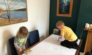 Richard MacCowan's two children create art under his watchful eye at home.