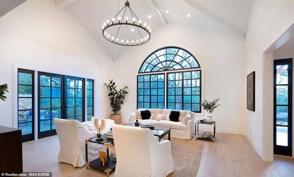 Spacious: The formal living area features arched windows, French oak floorboards and a vaulted ceiling with chandelier