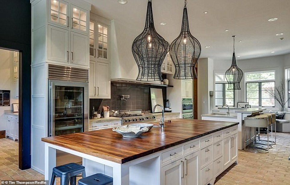 Gorgeous: Cutler had been living on the property since their split according to the site as Cavallari has already moved to a new home.; the kitchen island is shown as it includes a wood-finished top and ornate suspended lamps