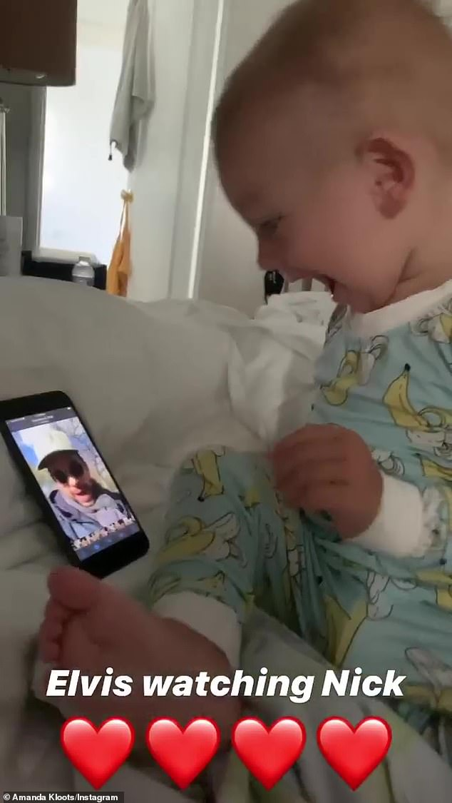 Daddy's boy: Kloots included another video in her Insta Stories of Elvis totally absorbed in a video his father