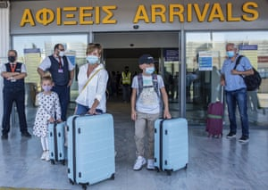 Tourists arrive in Heraklion, Crete, from Hamburg, Germany, with the first international flight to arrive in the island on Wednesday.