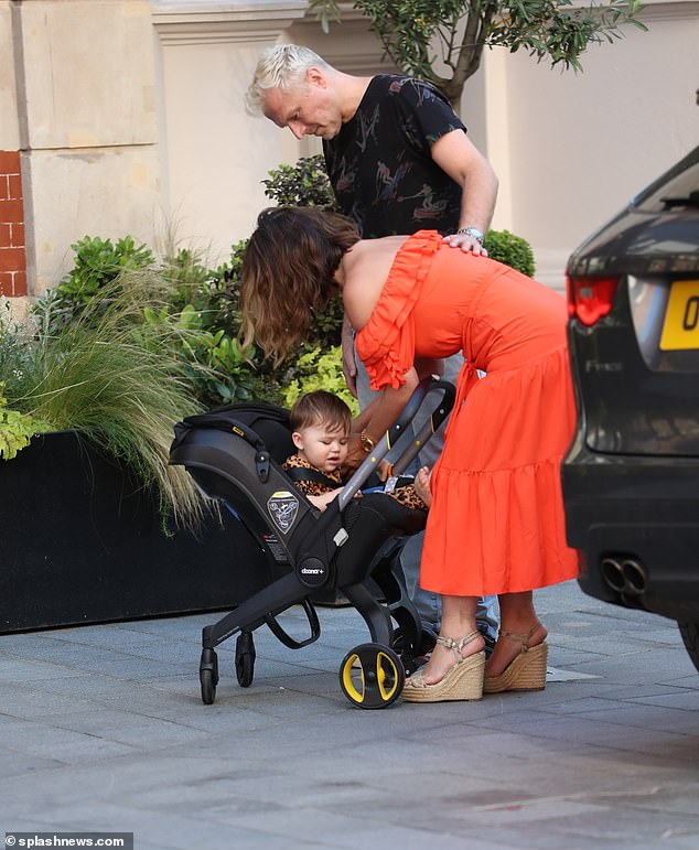 Family time: Myleene was joined by her husband Simon Motson and baby Apollo as she made the journey to work