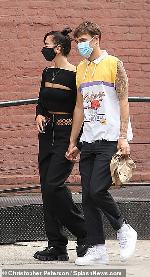 Happy couple: The duo cut cool figures as they strolled in New York together