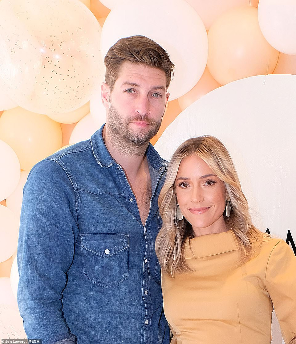 Better times: The reality star is in the middle of a divorce from former NFL star husband Jay Cutler, they are seen together last year