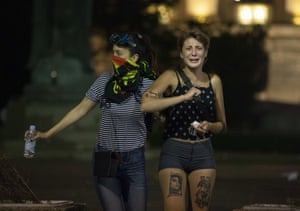 Thousands of people demonstrated in several Serbian cities on Friday. These two women were photographed in Belgrade.
