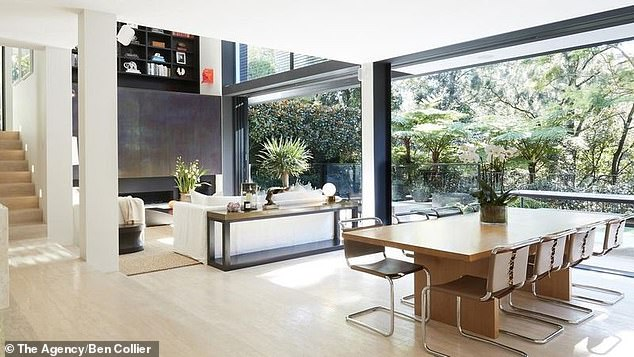 Stunning: The Woollahra estate has a large open living room with glass windows soaking in the beautiful greenery of Cooper Park