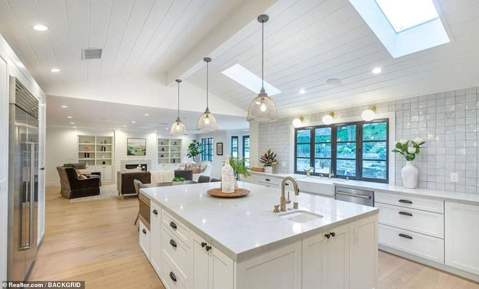 Chef's delight: The gourmet kitchen has a vaulted skylight over a large center island with marble countertops and high-end appliances