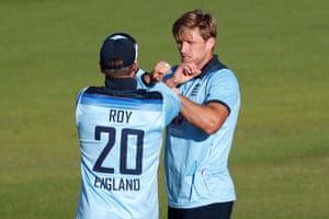 England's David Willey celebrates taking the wicket of Ireland's Gareth Delany with Jason Roy.