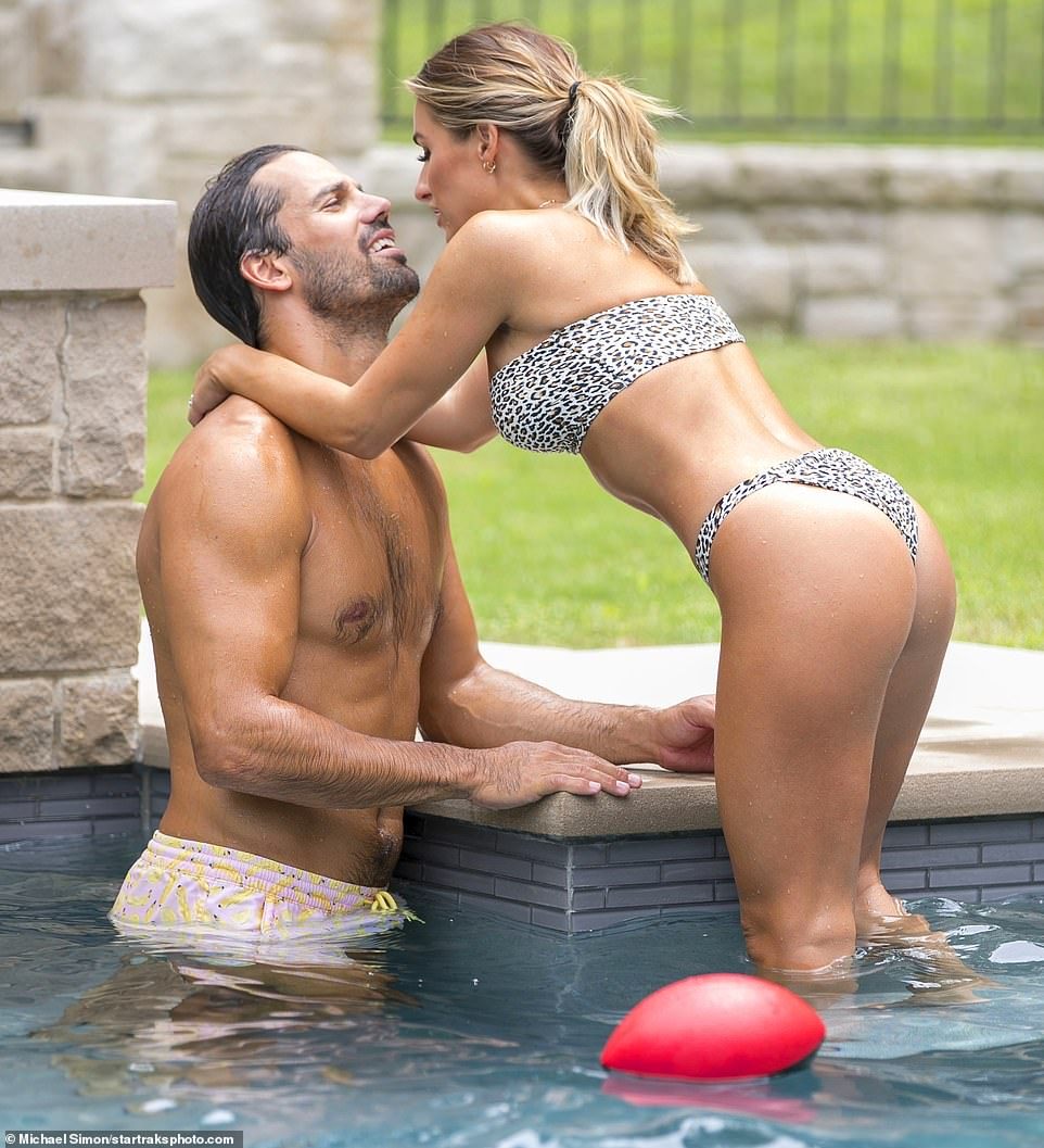 Loving: Jessie James Decker and her doting husband, Eric, couldn't keep their hands off each other, while posing for a number of shots to promote the September release of her cookbook. After leaning in for a kiss and splashing around their lavish swimming pool, she and the former NFL player, 33, appear to have fun tossing around a red football