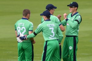 Ireland's Harry Tector (R) is congratulated by teammates after taking the catch to dismiss England's Eoin Morgan off the bowling of Ireland's Josh Little (L) for 106.