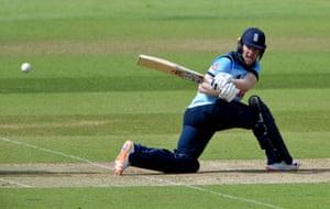 England captain Eoin Morgan sweeps a shot to the boundary.