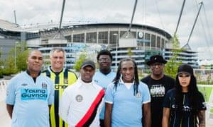 Members of City Matters, the official Manchester City fan network, including (third from right) . From left to right: Rodney Rhoden, David Southworth, Barrington Reeves, Hayden Jarrett, Andrew Bucknall, Don Grant, Reem Reynolds.
