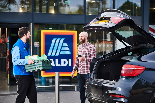 Aldi staff member bringing shopping to your car