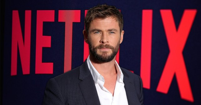Chris Hemsworth pictured in front of Netflix logo