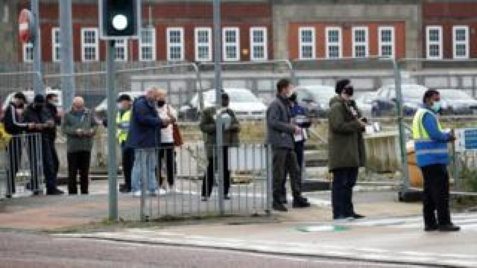 People queuing for a test in Bolton