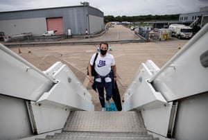 At Birmingham airport, Gareth Southgate boards the plane taking his squad to Iceland.