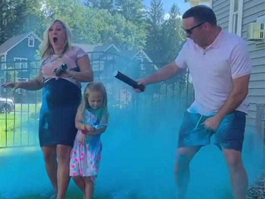 Gender reveal party with blue powder