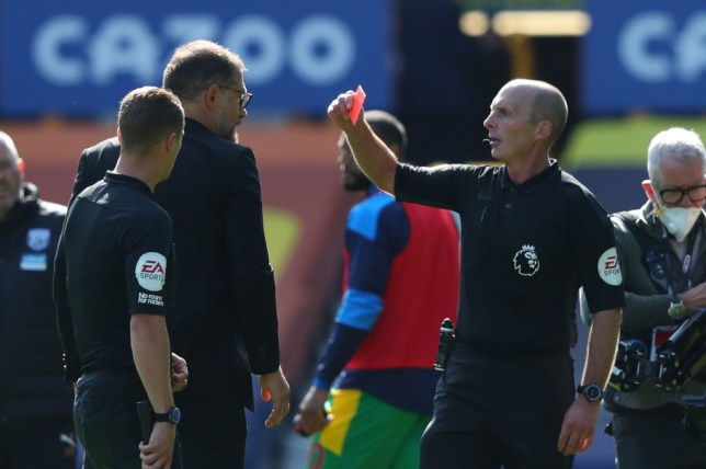 West Bromwich Albion's Croatian head coach Slaven Bilic (R) receives a red card from referee Mike Dean during the English Premier League football match between Everton and West Bromwich Albion at Goodison Park in Liverpool, north west England on September 19, 2020.